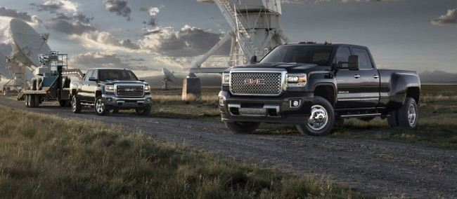 2015 GMC Sierra 2500 HD SLT (L) and Denali 3500 HD crew cab pick