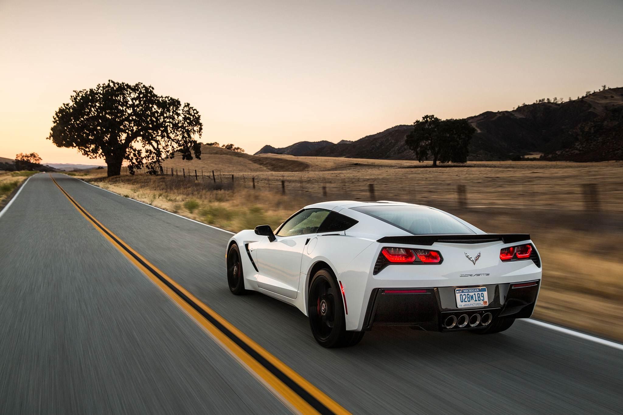 2015-chevrolet-corvette-stingray-rear-drivers-side-in-motion