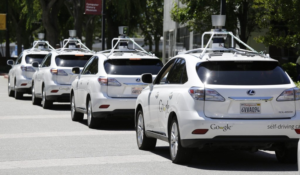 In this May 14, 2014 file photo, a row of Google self-driving cars are shown outside the Computer History Museum in Mountain View, Calif. For the first time, California's Department of Motor Vehicles knows how many self-driving cars are traveling on the state's public roads. The agency is issuing permits, Tuesday, Sept. 16, 2014 that let three companies test 29 vehicles on highways and in neighborhoods. (AP Photo/Eric Risberg, File)