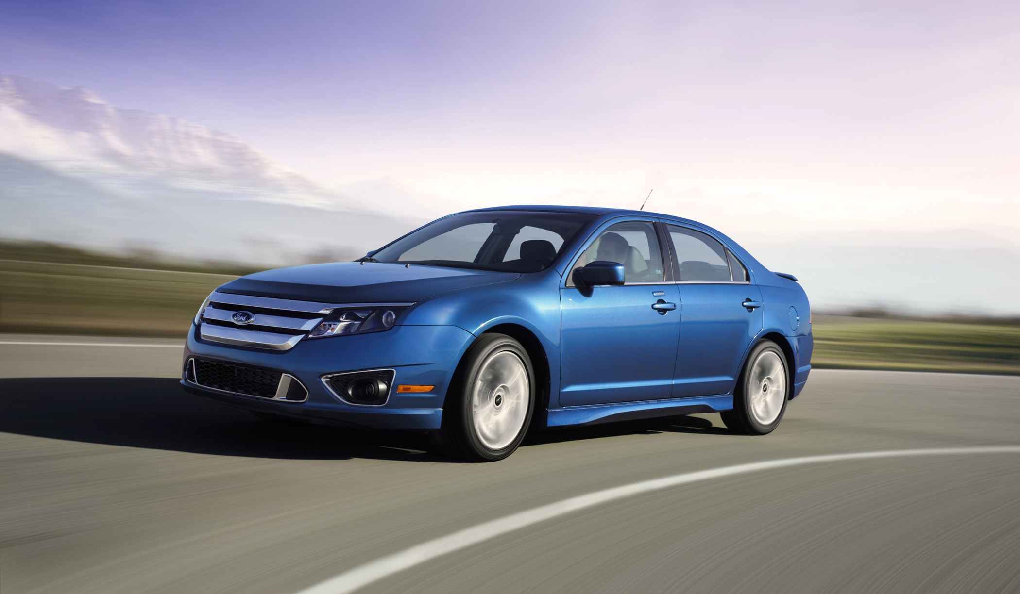 This product image provided by Ford Motor Co. shows a 2011 Ford Fusion. U.S. safety regulators are investigating complaints of power-assisted steering failure in 938,000 Ford Fusion and Lincoln MKZ cars from the 2010 through 2012 model years, as well as the 2011 Mercury Milan. (AP Photo/Ford Motor Co.)