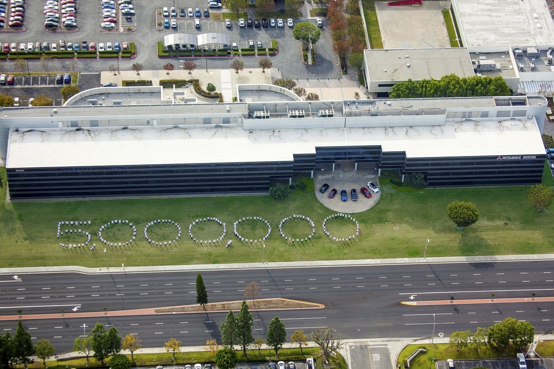 Mitsubishi employees at the Cypress, CA headquarters spell out 5,000,000.