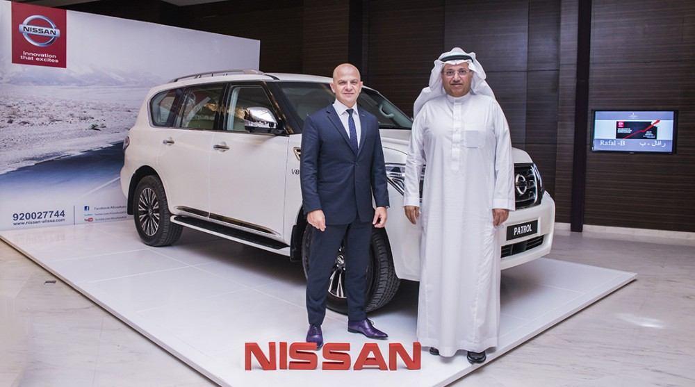 Mr. Cherfan and Shikeh Najeeb standing by Nissan Patrol