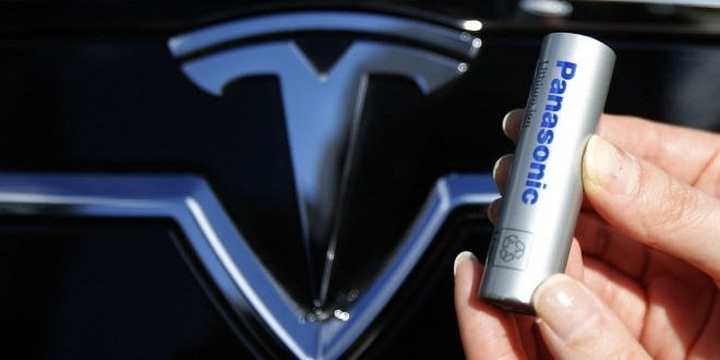 A Panasonic Corp's lithium-ion battery is pictured with Tesla Motors logo in Tokyo