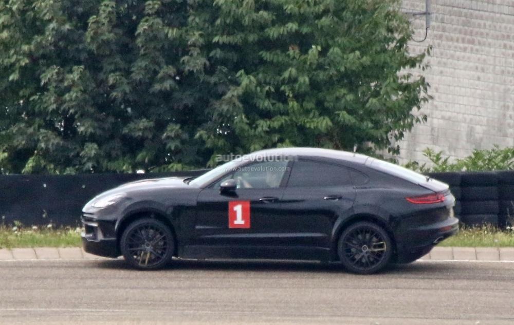 porsche-sahara-suv-coupe-makes-spyshot-debut-as-lifted-panamera-test-car-110148_1