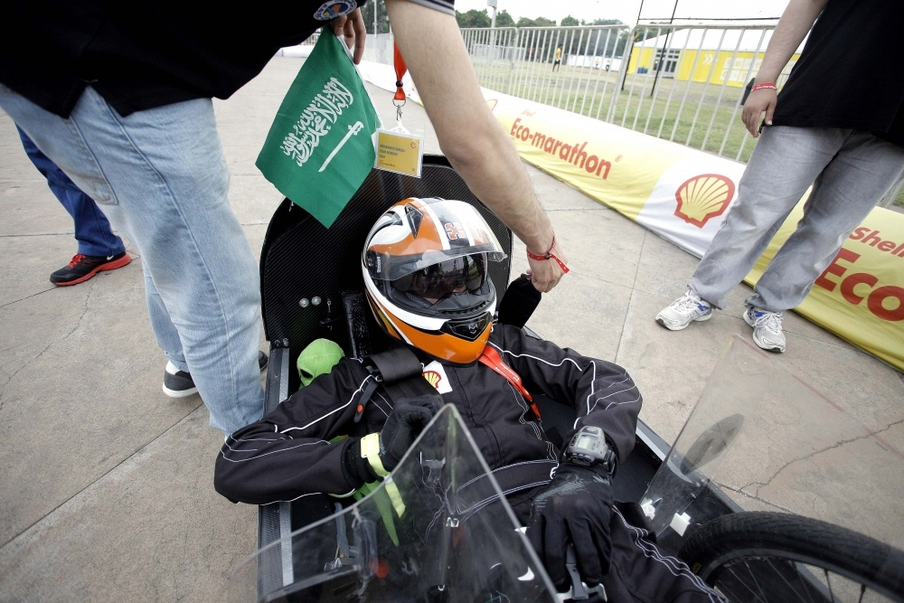 Team members of the Riyadh/2, #12, a gasoline prototype vehicle from team Saaf at the King Saud University in Riyadh, Saudi Arabia, ready their car for a run during day two of the Shell Eco-marathon Asia in Manila, Philippines, Friday, March 4, 2016. (Geloy Concepcion via AP Images)
