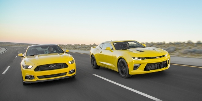2016-chevrolet-camaro-ss-vs-ford-mustang-gt-front-three-quarter-in-motion
