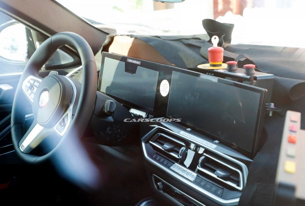 صور تجسسية لــ بي إم دبليو X6 المحدثة تكشف عن تصميم داخلي جديد 2023-BMW-X6-2-1000x675