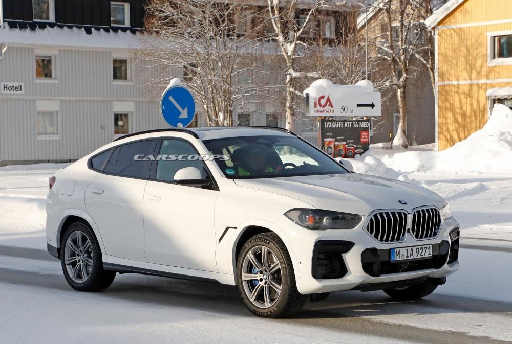 صور تجسسية لــ بي إم دبليو X6 المحدثة تكشف عن تصميم داخلي جديد 2023-BMW-X6-8-1000x673