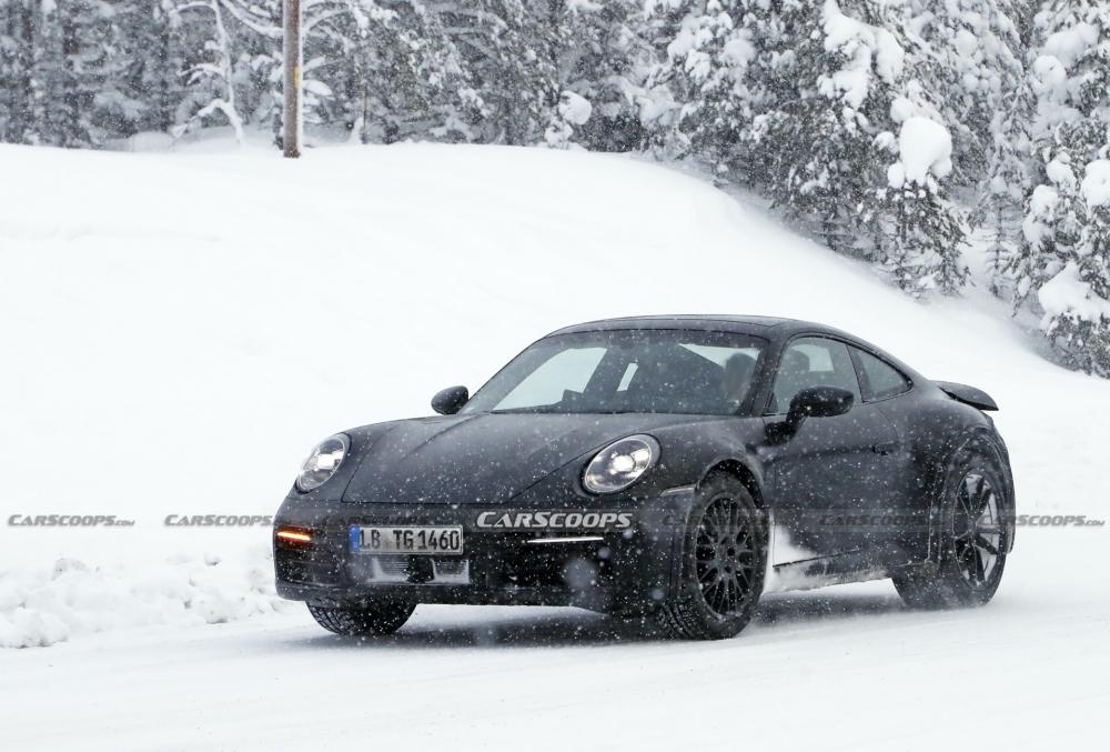 أول صور تجسسية لــ بورش 911 سفاري Porsche-911-Safari-Prototype-39-1000x677
